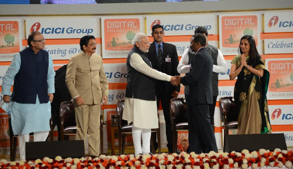 M.Nagarajan IAS being felicitated for creating Digital Village by Hon. PM Narendra Modi
